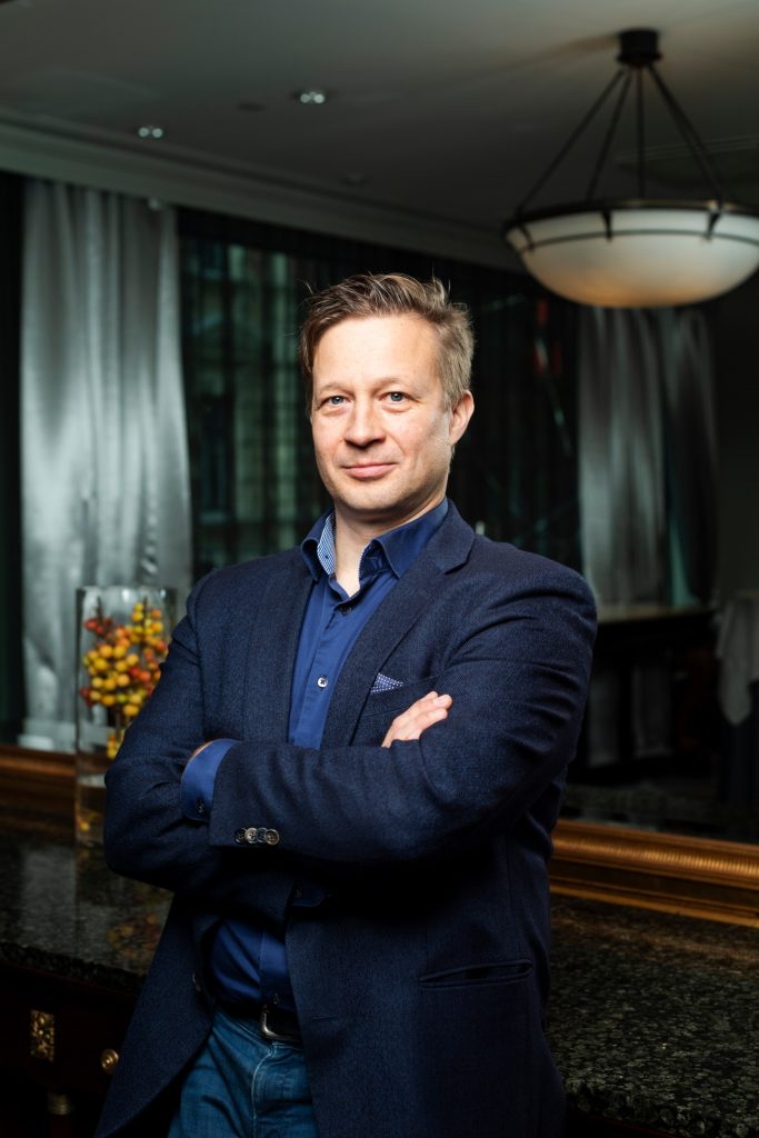 CTO of Elinar, Ari Juntunen in dark room for the Business Class magazine