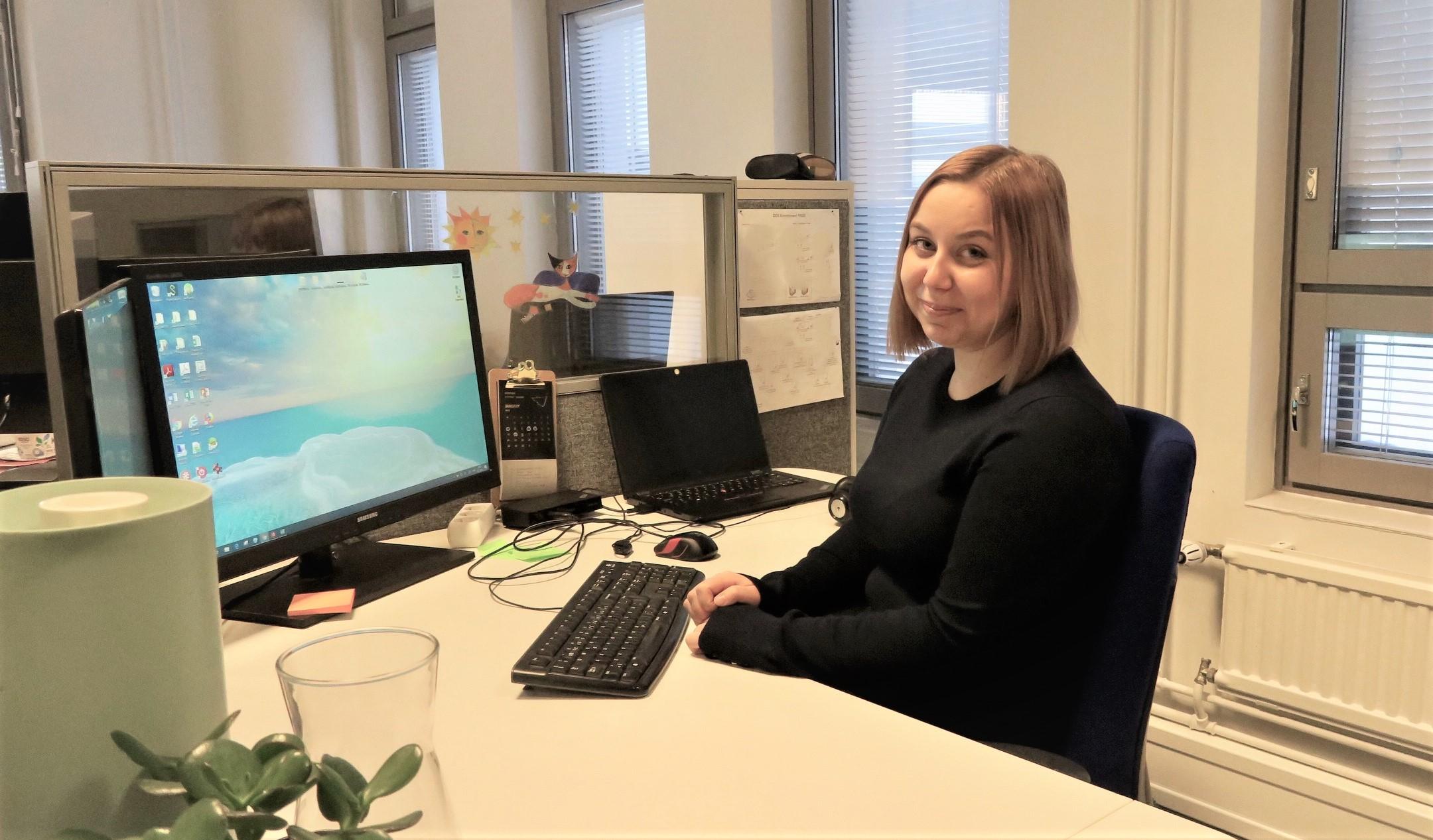 Elinar's Software Designer Kaisa Rauta sitting in front of her desk