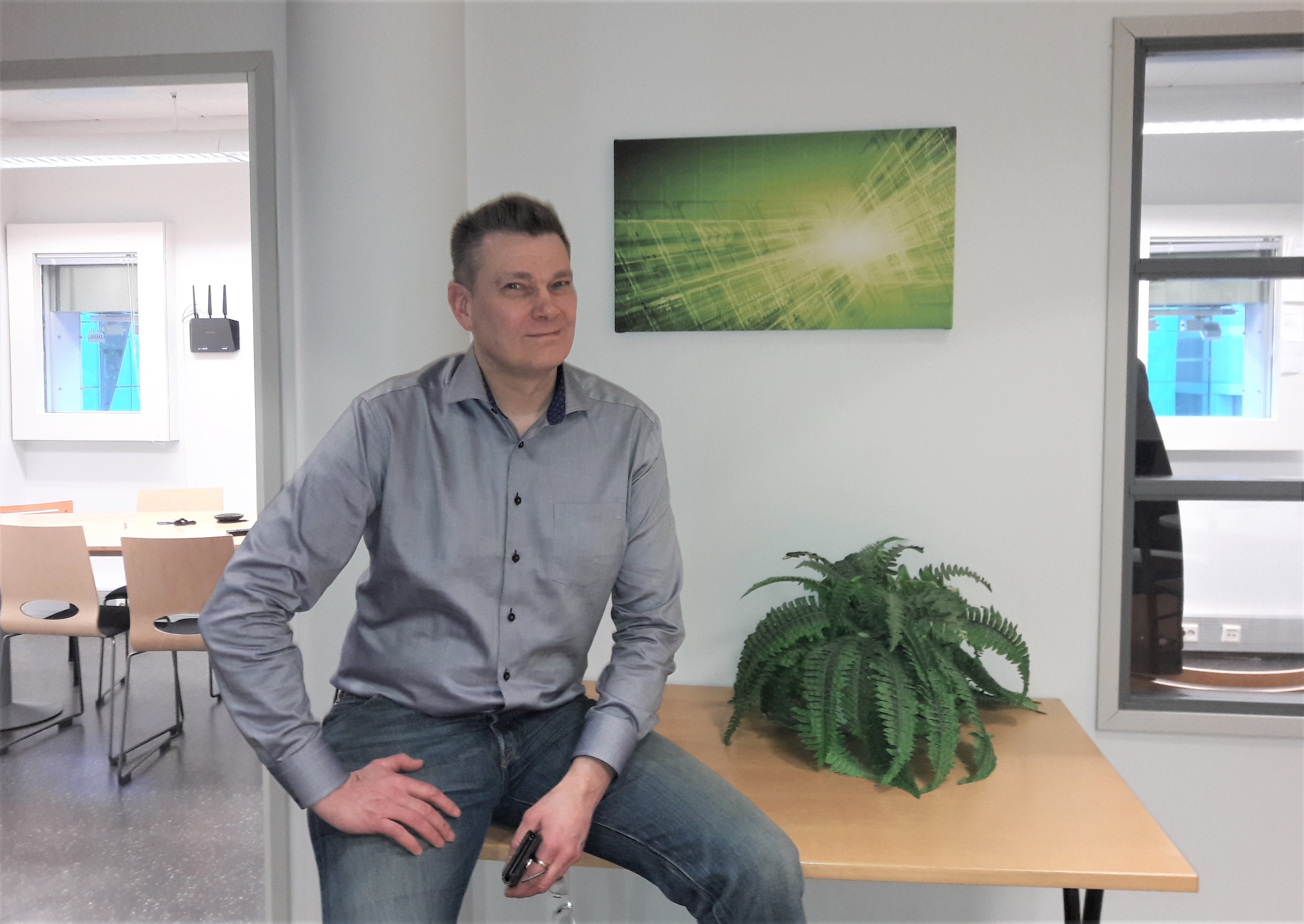 Project Manager of Elinar, Mikko Arohonka sitting in Elinar's office