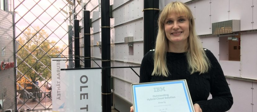 Leena Tähti holds an award for Elinar's AI integration with IBM's technology